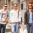 Three Young male fashion shop shopping walk — Stock Photo #48072493