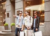 Three Young male fashion metraseksuals shop shopping walk — Stock Photo
