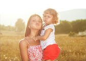 Mother and daughter having fun in the mountains — Стоковое фото