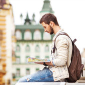 Tourist with map in the city — Stock Photo