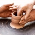 Постер, плакат: Female Potter creating a bowl on a Potters wheel the master pot