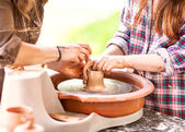 Female Potter creating a bowl on a Potters wheel, the master pot — Stock Photo