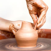 Hands working on pottery wheel , retro style toned — Foto Stock