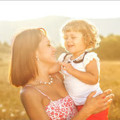 Mother and daughter having fun in the park — Stock Photo