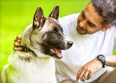 Man and Akita Inu dog walk in the park. — Stock Photo