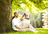 Man and Dog Argentino walk in the park. — Stock Photo