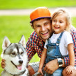 Father and  daughter playing in the park in love with Dog Husky — Stock Photo #51262885