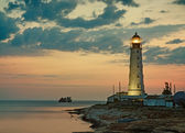 Old lighthouse on sea coast — Stock Photo