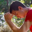 Man Praying in Nature - Stock Photo