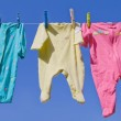 Cute Baby Clothes Hanging — Stock Photo