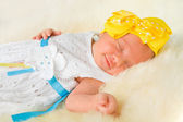 Newborn Baby Girl Sleeping on Fluff — Stock Photo
