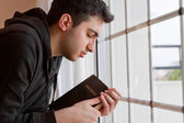 Man Praying by Window — Stock Photo