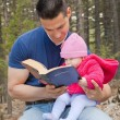 Dad and Baby Daughter Reading Bible — Stock Photo #25015561