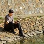 Man Reading Bible By Lake — Stock Photo