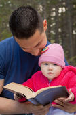 Dad and Baby Daughter Reading Bible — Stock Photo