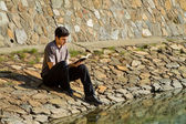 Man Reading Bible By Lake — Stock Photo