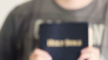 Young Man Proudly Showing Off His Bible — Vídeo Stock