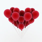 Red balls in the shape of a heart — Stock Photo