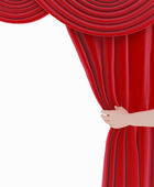 Red curtain and hand. — Stock Photo
