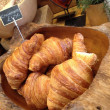 Croissant in a wooden bowl — Stockfoto