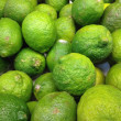 Key Lime on sale at the market — Stock Photo