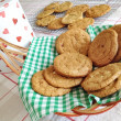 图库照片: Homebaked chocolate chip cookies. Baking, biscuits, cookie jar, basket, table setting, munch, yummy