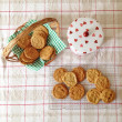 Homebaked chocolate chip cookies. Baking, biscuits, cookie jar, basket, table setting, munch, yummy — Stock fotografie #36926737