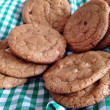 Homebaked chocolate chip cookies. Baking, biscuits, cookie jar, basket, table setting, munch, yummy — Stock fotografie #36926741
