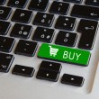Computer keyboard - glowing buy key — Stock Photo