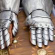 Pair of armored gloves over jay bale - Stock Photo