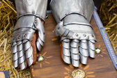 Pair of armored gloves over jay bale — Stock Photo