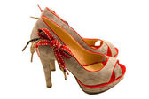 High-heeled shoes with red bow — Stock Photo