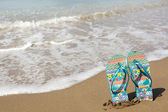Blue beach slippers on sandy beach, summer, bathing — Stock Photo
