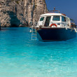 Boat anchored on Navagio beach (also known as shipwreck beach), — Stok fotoğraf