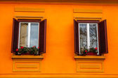 Vintage window on orange cement wall — Stock Photo