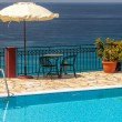 Swimming pool near the sea , Greece — Stock Photo #25344673