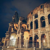 Vintage coaster - Italy Illuminated Colosseum at night — Stock Photo