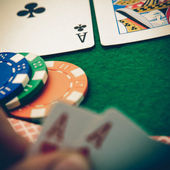 Texas holdem pocket aces on casino table — Stock Photo