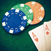 Vintage - Texas holdem pocket aces on casino table with copy spa — Stock Photo