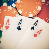 Vintage poker, four aces over a background with casino chips — 图库照片