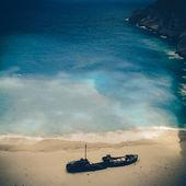Beach Navagio in Zakynthos, Greece - vintage coaster — Stock Photo