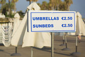 Umbrellas and sunbeds for hire — Stock Photo