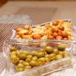 Olives and asian snacks — Stock Photo