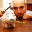 Breaking the piggy bank — Stock Photo