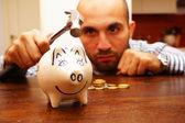 Breaking the piggy bank — Stock Photo