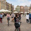 Bicyclers in old square of Poznan — Stock Photo #26328207
