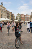 Bicyclers in the old square of Poznan — Stock Photo