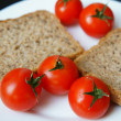 Bread and tomatoes — Stock Photo #26330243