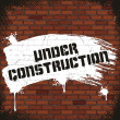 Under Construction Sign, Painted on Old Brick Wall — Stock Photo