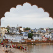 Pilgrims bathe in the holy waters during the Pushkar fair — Stock Photo